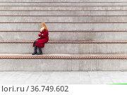 Young woman sits alone in empty stands. Стоковое фото, фотограф Евгений Харитонов / Фотобанк Лори