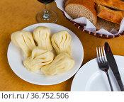 Hearty Georgian dumplings khinkali with meat filling. Стоковое фото, фотограф Яков Филимонов / Фотобанк Лори