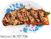 Toasted bread with chopped tuna, anchovies and baked bell pepper. Стоковое фото, фотограф Яков Филимонов / Фотобанк Лори