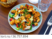 Popular dish of American cuisine is a warm Caesar salad with fried chicken and champignons. Стоковое фото, фотограф Яков Филимонов / Фотобанк Лори
