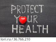 Protect your health concept phrase handwritten on the blackboard. Стоковое фото, фотограф Zoonar.com/Yury Zap / easy Fotostock / Фотобанк Лори