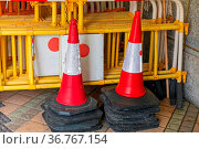 Stacked Traffic Cones and Construction Barriers Barricades. Стоковое фото, фотограф Zoonar.com/Marko Beric / easy Fotostock / Фотобанк Лори