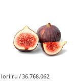 Whole fruit and fig slices on white background. Стоковое фото, фотограф Zoonar.com/DANK0 NN / easy Fotostock / Фотобанк Лори