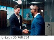 Businessman handshake success deal team at office meeting. Business... Стоковое фото, фотограф Zoonar.com/Max / easy Fotostock / Фотобанк Лори