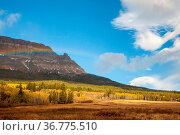 Rainbow in front of a mountain near Saint Mary Lake, Glacier National... Стоковое фото, фотограф Zoonar.com/Tomas Nevesely / easy Fotostock / Фотобанк Лори