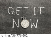 Get it now phrase handwritten on chalkboard with vintage precise stopwatch... Стоковое фото, фотограф Zoonar.com/Yury Zap / easy Fotostock / Фотобанк Лори