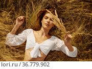 Erotic woman in lingerie lying in hay in the field. Стоковое фото, фотограф Tryapitsyn Sergiy / Фотобанк Лори
