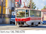 "Russia, Nizhny Tagil, July 2021: Tram car 71-403 ""Spectrum-3"" on Lenin Avenue on a sunny summer day. Редакционное фото, фотограф Акиньшин Владимир / Фотобанк Лори"