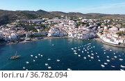 Picturesque aerial view of Mediterranean coastal town and resort of Cadaques in Catalonia, Spain. Стоковое видео, видеограф Яков Филимонов / Фотобанк Лори