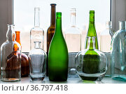 Various empty bottles on windowsill at home on sunny spring day. Стоковое фото, фотограф Zoonar.com/Valery Voennyy / easy Fotostock / Фотобанк Лори