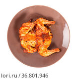 Top view of roasted whole flattened chicken on brown plate isolated... Стоковое фото, фотограф Zoonar.com/Valery Voennyy / easy Fotostock / Фотобанк Лори