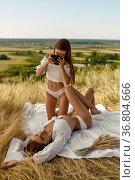 Erotic women in lingerie, photosession in field. Стоковое фото, фотограф Tryapitsyn Sergiy / Фотобанк Лори
