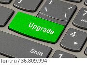 Computer notebook keyboard with Upgrade key - technology background. Стоковое фото, фотограф Zoonar.com/Nikolai Sorokin / easy Fotostock / Фотобанк Лори