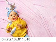 Baby girl laugh with mobile toys view from above. Стоковое фото, фотограф Сергей Новиков / Фотобанк Лори
