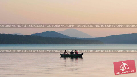 05-08-2020 KAZAN, RUSSIA: three men sitting in the boat on river - landscape of mountains, forest and river. Редакционное видео, видеограф Константин Шишкин / Фотобанк Лори