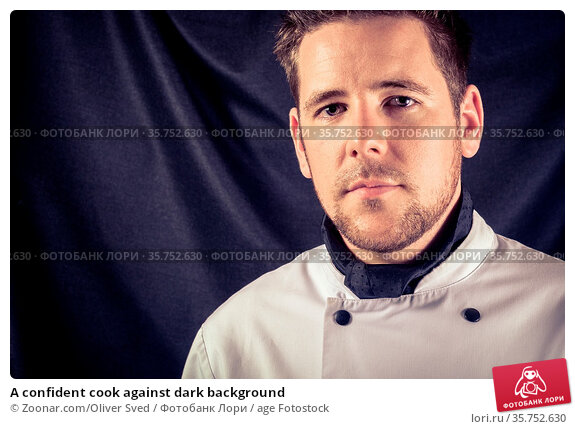 A confident cook against dark background. Стоковое фото, фотограф Zoonar.com/Oliver Sved / age Fotostock / Фотобанк Лори
