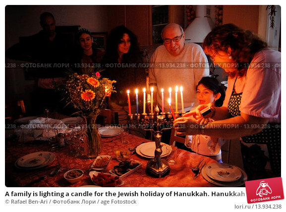 Купить «A family is lighting a candle for the Jewish holiday of Hanukkah. Hanukkah or Chanukah, Chanukkah, or Chanuka, also known as the Festival of Lights, is...», фото № 13934238, снято 30 ноября 2007 г. (c) age Fotostock / Фотобанк Лори