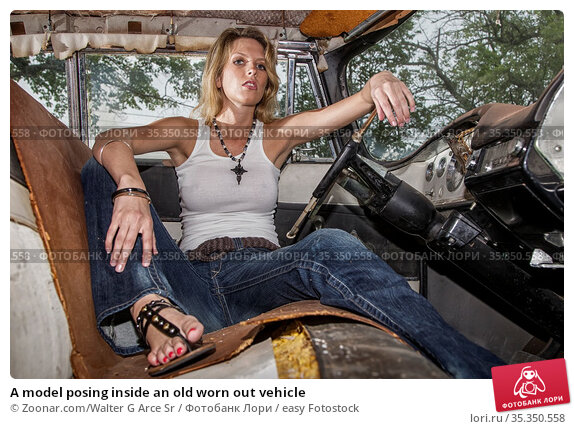 A model posing inside an old worn out vehicle. Стоковое фото, фотограф Zoonar.com/Walter G Arce Sr / easy Fotostock / Фотобанк Лори