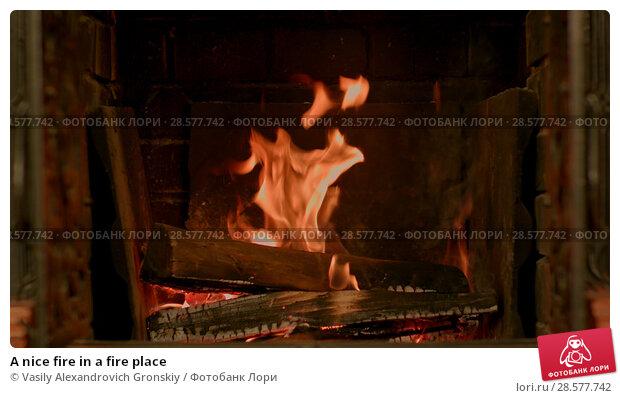 Купить «A nice fire in a fire place», фото № 28577742, снято 18 июня 2018 г. (c) Vasily Alexandrovich Gronskiy / Фотобанк Лори