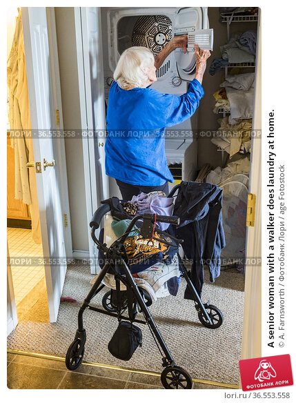 A senior woman with a walker does laundry at home. Стоковое фото, фотограф A. Farnsworth / age Fotostock / Фотобанк Лори