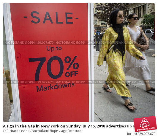 Купить «A sign in the Gap in New York on Sunday, July 15, 2018 advertises up to 70% off on merchandise in the chain's store. (© Richard B. Levine).», фото № 29027670, снято 15 июля 2018 г. (c) age Fotostock / Фотобанк Лори