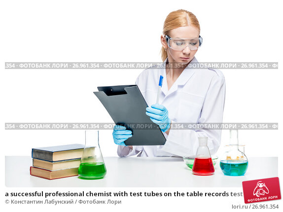 a successful professional chemist with test tubes on the table records test results, фото № 26961354, снято 4 апреля 2017 г. (c) Константин Лабунский / Фотобанк Лори