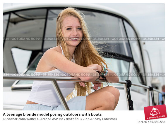 A teenage blonde model posing outdoors with boats. Стоковое фото, фотограф Zoonar.com/Walter G Arce Sr ASP Inc / easy Fotostock / Фотобанк Лори