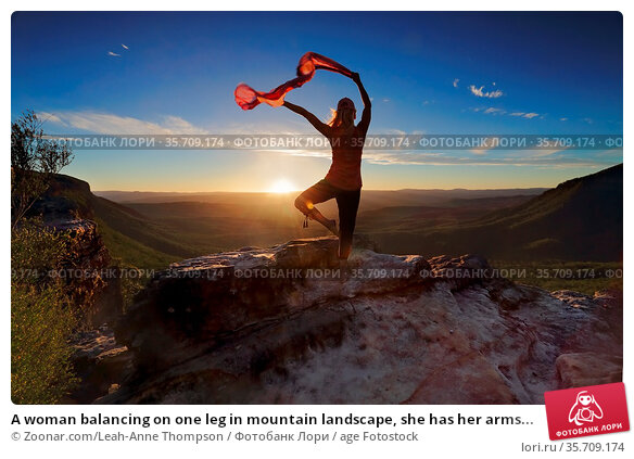A woman balancing on one leg in mountain landscape, she has her arms... Стоковое фото, фотограф Zoonar.com/Leah-Anne Thompson / age Fotostock / Фотобанк Лори