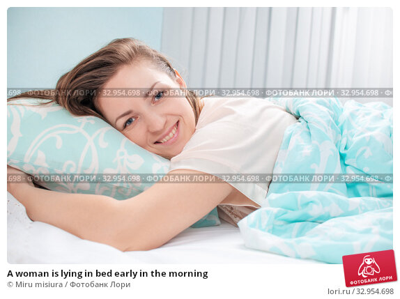 A woman is lying in bed early in the morning. Стоковое фото, фотограф Miru misiura / Фотобанк Лори