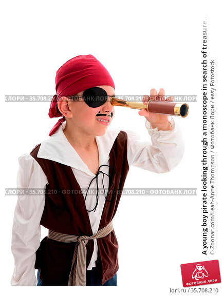 A young boy pirate looking through a monoscope in search of treasure... Стоковое фото, фотограф Zoonar.com/Leah-Anne Thompson / easy Fotostock / Фотобанк Лори