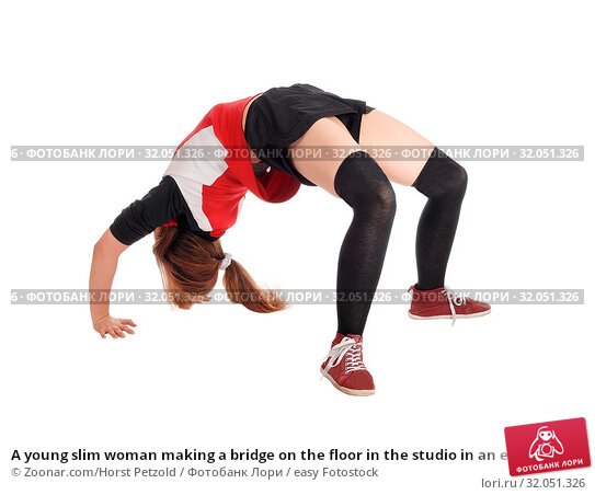 A young slim woman making a bridge on the floor in the studio in an exercise outfit, isolated for white background. Стоковое фото, фотограф Zoonar.com/Horst Petzold / easy Fotostock / Фотобанк Лори