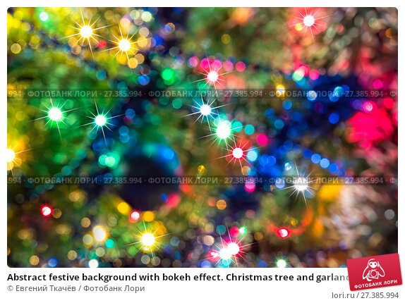 Купить «Abstract festive background with bokeh effect. Christmas tree and garlands of bright», фото № 27385994, снято 19 января 2016 г. (c) Евгений Ткачёв / Фотобанк Лори
