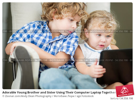 Adorable Young Brother and Sister Using Their Computer Laptop Together... Стоковое фото, фотограф Zoonar.com/Andy Dean Photography / age Fotostock / Фотобанк Лори