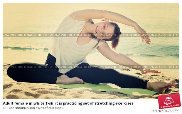 Adult female in white T-shirt is practicing set of stretching exercises, фото № 26762790, снято 15 мая 2017 г. (c) Яков Филимонов / Фотобанк Лори