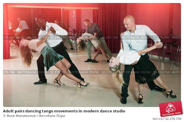 Купить «Adult pairs dancing tango movements in modern dance studio», фото № 32276150, снято 4 октября 2018 г. (c) Яков Филимонов / Фотобанк Лори