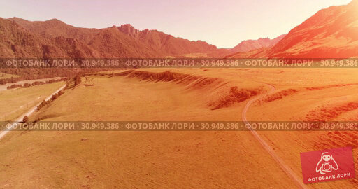 Купить «Aerial rural mountain road and meadow at sunny summer morning. Asphalt highway and river.», видеоролик № 30949386, снято 29 ноября 2017 г. (c) Александр Маркин / Фотобанк Лори