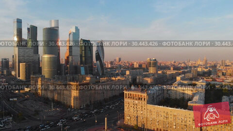 Купить «Aerial top view of road junction in Moscow from above, automobile traffic and jam of many cars, transportation concept», видеоролик № 30443426, снято 27 марта 2019 г. (c) Mikhail Starodubov / Фотобанк Лори