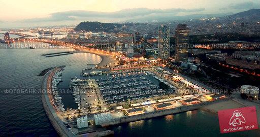 Купить «Aerial view of autumn twilight in Barcelona, Spain», видеоролик № 33045262, снято 27 сентября 2018 г. (c) Яков Филимонов / Фотобанк Лори