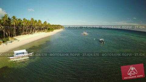 Купить «Aerial view of Bohol coast Island with boats. Aerial. Fisheye view. Philippines.», видеоролик № 27424578, снято 20 января 2018 г. (c) Mikhail Davidovich / Фотобанк Лори
