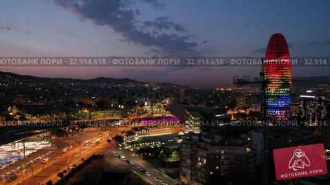 Купить «Aerial view of illuminated multicolored Torre Agbar with night cityscape on background», видеоролик № 32914618, снято 28 июня 2019 г. (c) Яков Филимонов / Фотобанк Лори