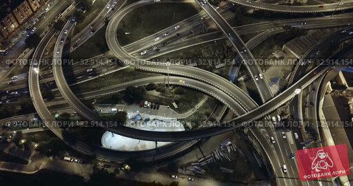 Купить «Aerial view of lighted highway road junctions at night», видеоролик № 32914154, снято 26 октября 2018 г. (c) Яков Филимонов / Фотобанк Лори
