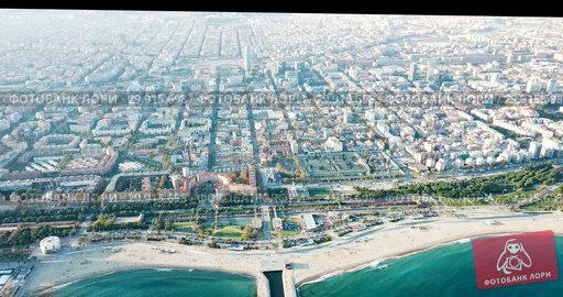Купить «Aerial view of Mediterranean Sea coast of Barcelona, Spain», видеоролик № 29915698, снято 16 ноября 2018 г. (c) Яков Филимонов / Фотобанк Лори