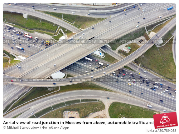 Купить «Aerial view of road junction in Moscow from above, automobile traffic and jam of many cars, road junction on the Moscow Ring Road and the M11 toll road», фото № 30789058, снято 23 января 2020 г. (c) Mikhail Starodubov / Фотобанк Лори