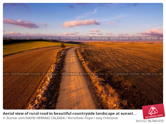 Aerial view of rural road in beautiful countryside landscape at sunset... Стоковое фото, фотограф Zoonar.com/DAVID HERRAEZ CALZADA / easy Fotostock / Фотобанк Лори