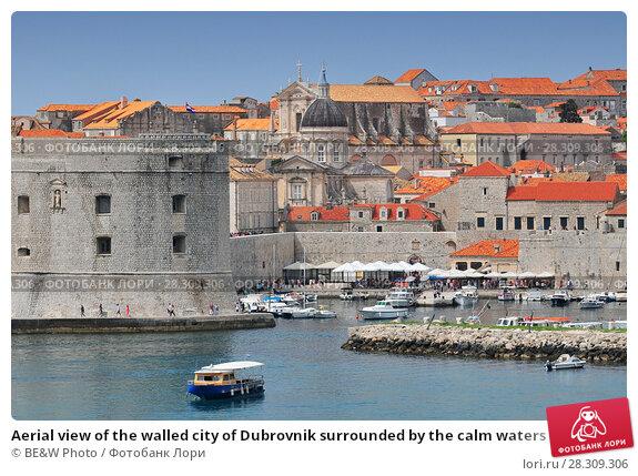 Купить «Aerial view of the walled city of Dubrovnik surrounded by the calm waters of the Adriatic Sea, Croatia», фото № 28309306, снято 21 февраля 2019 г. (c) BE&W Photo / Фотобанк Лори