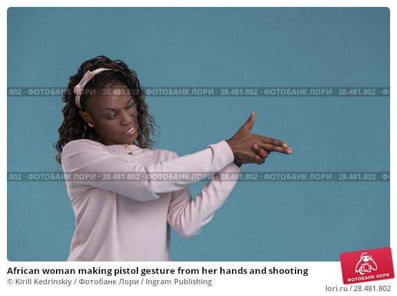 Купить «African woman making pistol gesture from her hands and shooting», фото № 28481802, снято 19 ноября 2014 г. (c) Ingram Publishing / Фотобанк Лори