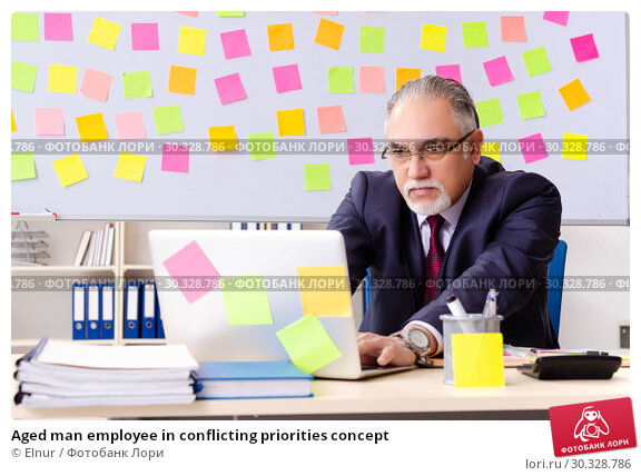 Купить «Aged man employee in conflicting priorities concept», фото № 30328786, снято 25 декабря 2018 г. (c) Elnur / Фотобанк Лори