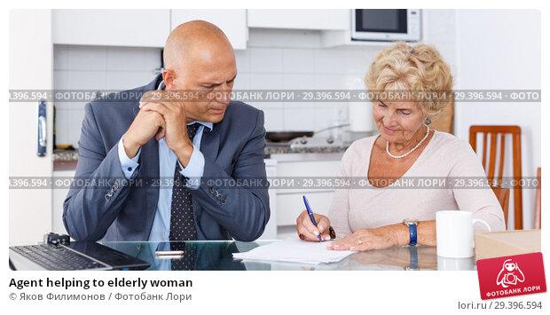 Купить «Agent helping to elderly woman», фото № 29396594, снято 11 июля 2018 г. (c) Яков Филимонов / Фотобанк Лори