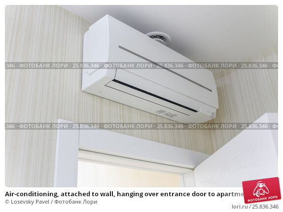 Air-conditioning, attached to wall, hanging over entrance door to apartment, фото № 25836346, снято 9 марта 2015 г. (c) Losevsky Pavel / Фотобанк Лори