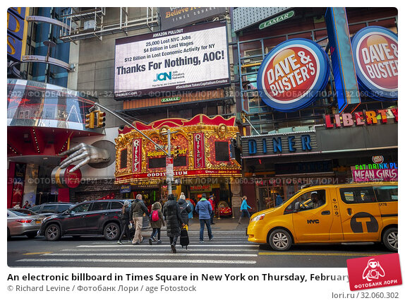 An electronic billboard in Times Square in New York on Thursday, February 21, 2019 chastises Alexandria Ocasio-Cortez (AOC) (D-NY) for squashing the deal... Редакционное фото, фотограф Richard Levine / age Fotostock / Фотобанк Лори